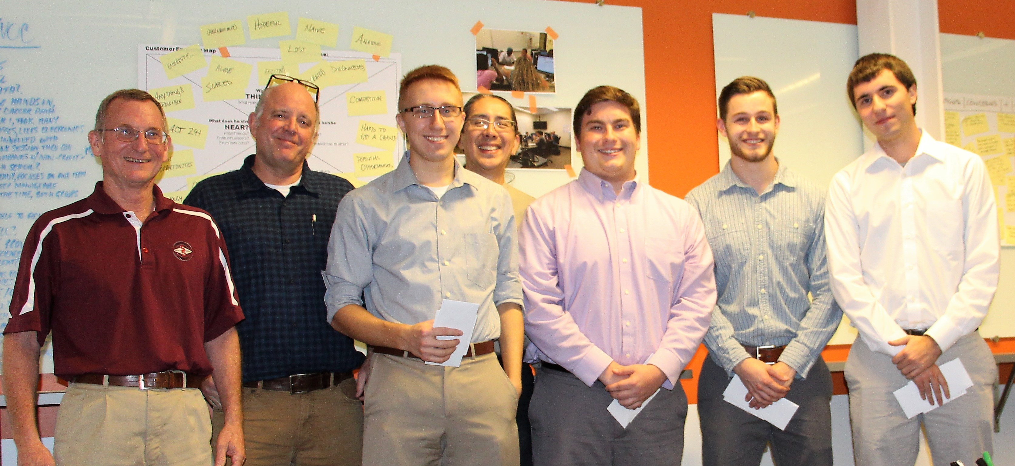 The winning student design team (Alex Machtay, Matt Rowland, Robert Jankovsky, and Adam DeNise) joined by judges Mel DeJarnette with Select Sires and Dr. Bill Benson and Michael Luh from Worthington Industries